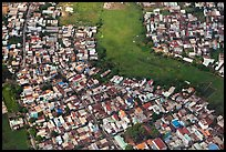 Aerial view of houses and fields on the outskirts of the city. Ho Chi Minh City, Vietnam (color)