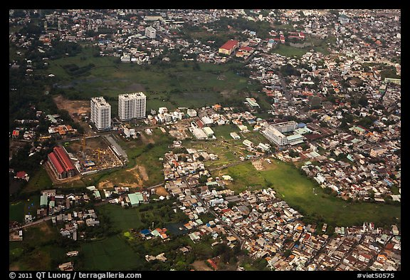 Aerial view of houses and high-rises on the outskirts of the city. Ho Chi Minh City, Vietnam (color)