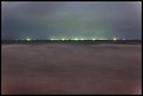 South China Sea at night with lights of fishing boats on horizon. Mui Ne, Vietnam (color)