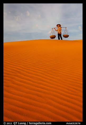 Woman on top of dune field. Mui Ne, Vietnam (color)