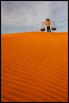 Woman on top of dune field. Mui Ne, Vietnam ( color)