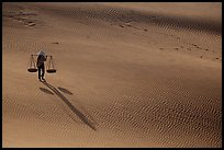 Shadows of woman on dune field. Mui Ne, Vietnam ( color)