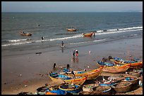 Boats and fishermen on beach. Mui Ne, Vietnam (color)