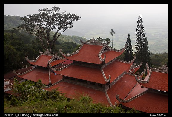 Temple rooftop overlooking plains in mist. Ta Cu Mountain, Vietnam (color)