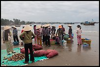 Shore activity in front of Lang Chai fishing village. Mui Ne, Vietnam (color)