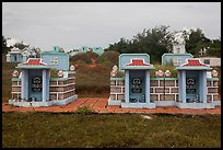 Mix of Buddhist and Christian tombs. Mui Ne, Vietnam ( color)