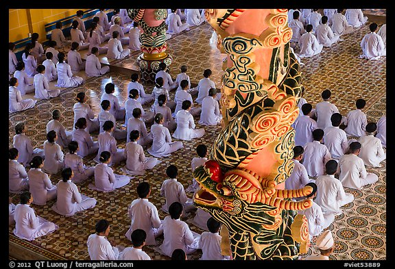 Column and worshippers, Cao Dai Holy See temple. Tay Ninh, Vietnam (color)