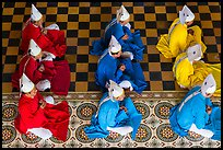 Cao Dai dignitaries wearing red (Confucian), blue (Taois) and yellow (Buddhist). Tay Ninh, Vietnam ( color)