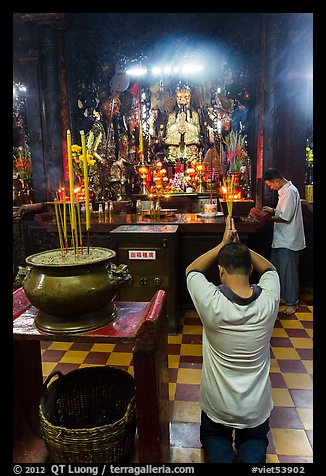 Worshippers inside Jade Emperor Pagoda. Ho Chi Minh City, Vietnam (color)