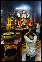 Worshippers inside Jade Emperor Pagoda. Ho Chi Minh City, Vietnam ( color)