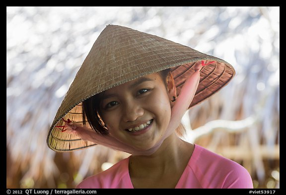 Portrait of girl with conical hat, Phoenix Island. My Tho, Vietnam (color)