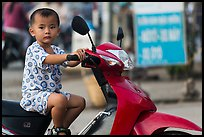 Boy on scooter. Can Tho, Vietnam ( color)