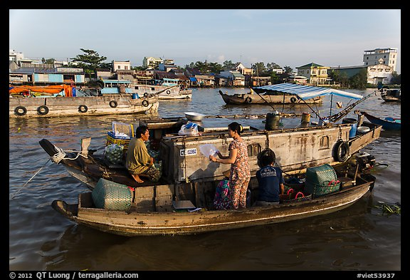 Seller and buyer talking across boats, Cai Rang floating market. Can Tho, Vietnam (color)