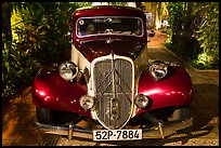Old Citroen car in garden. Ho Chi Minh City, Vietnam (color)
