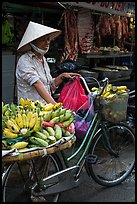Woman selling bananas from bicycle. Ho Chi Minh City, Vietnam (color)