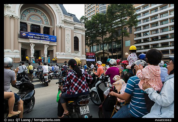 Families gather on moterbikes to watch musical performance. Ho Chi Minh City, Vietnam