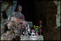 Altar and Buddha statue in cave. Da Nang, Vietnam (color)