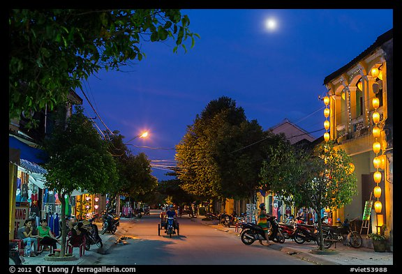 Street at dusk with moon and lanterns. Hoi An, Vietnam (color)