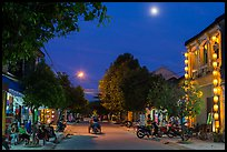 Street at dusk with moon and lanterns. Hoi An, Vietnam ( color)
