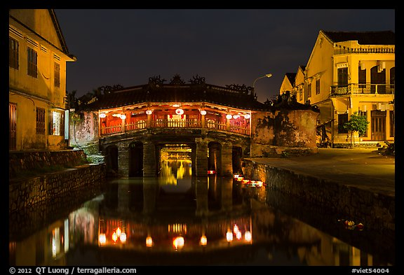 Covered Japanese Bridge reflected in canal by night. Hoi An, Vietnam (color)