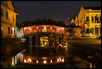 Covered Japanese Bridge reflected in canal by night. Hoi An, Vietnam ( color)