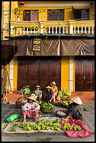 Banana vendors and historic house. Hoi An, Vietnam (color)