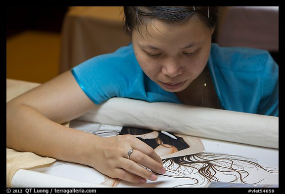 Woman working on a silk embroidery piece. Hoi An, Vietnam (color)
