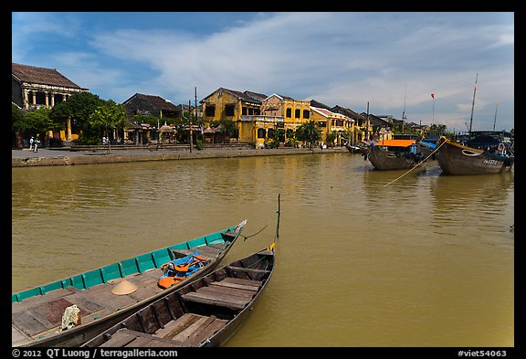 Boats, Thu Bon River, and houses. Hoi An, Vietnam (color)