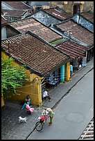 Old houses with tile rooftops and street from above. Hoi An, Vietnam (color)