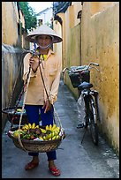 Fruit vendor carrying bananas. Hoi An, Vietnam ( color)
