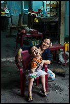 Boy and woman in kitchen. Hoi An, Vietnam ( color)