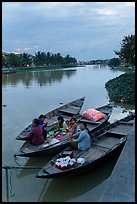 Family having dinner on boats at dusk. Hoi An, Vietnam (color)