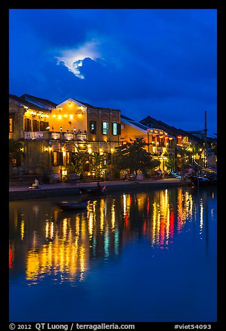 Ancient townhouses and moon reflected in river. Hoi An, Vietnam (color)