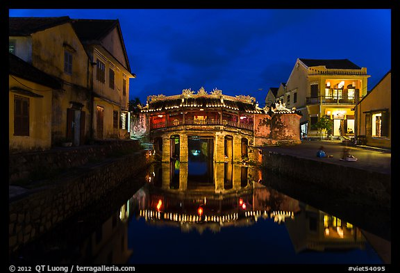 Japanese covered bridge reflected in canal at night. Hoi An, Vietnam (color)