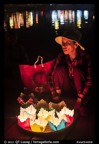 Woman selling floating candles at night. Hoi An, Vietnam (color)