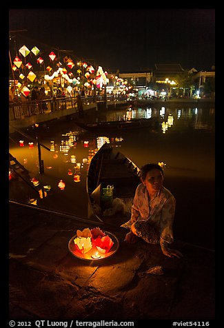 Woman selling candle lanterns by the bridge. Hoi An, Vietnam (color)