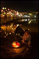 Woman selling candle lanterns by the bridge. Hoi An, Vietnam ( color)