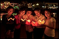 Group of women holding candles. Hoi An, Vietnam (color)
