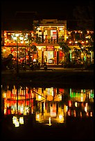 Waterfront house reflected in river at night. Hoi An, Vietnam (color)