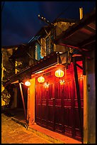 Townhouse with wooden doors lighted by paper lanterns. Hoi An, Vietnam (color)