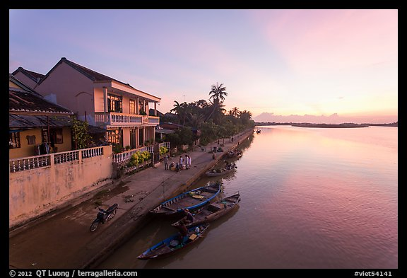 Sunrise over river and waterfront houses. Hoi An, Vietnam (color)