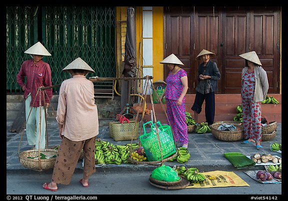 Curbside fruit vendors. Hoi An, Vietnam (color)