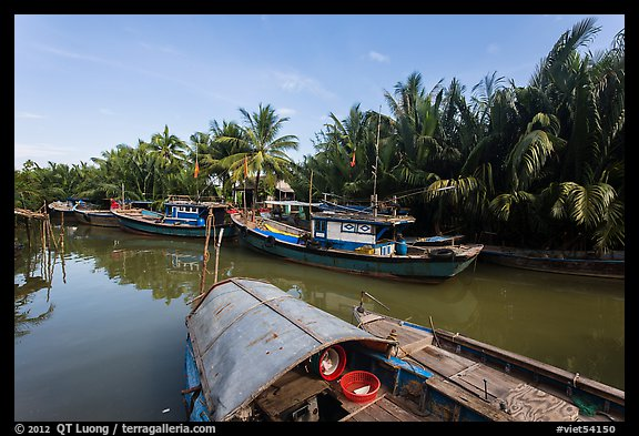 River channel and boats near Cam Kim Village. Hoi An, Vietnam (color)