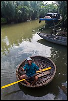 Man in circular boat near Cam Kim Village. Hoi An, Vietnam (color)