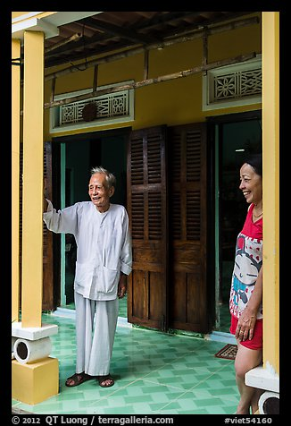 Woman and elder on porch of their house, Cam Kim Village. Hoi An, Vietnam (color)