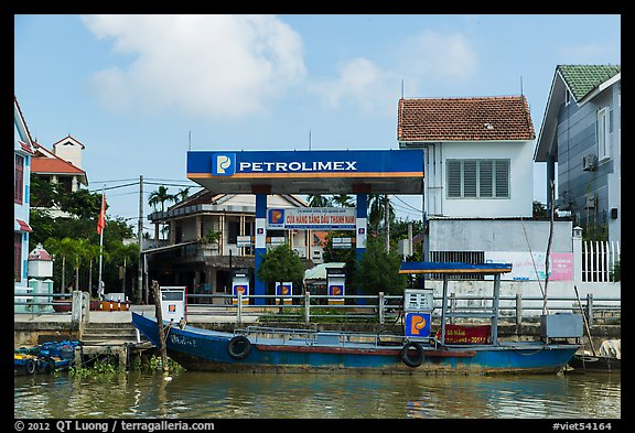 Road and river petrol station. Hoi An, Vietnam (color)