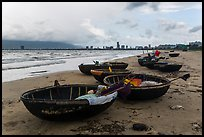 Coracle boats and city skyline. Da Nang, Vietnam ( color)
