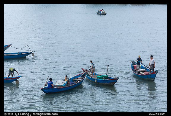 Fishermen on small boats. Vietnam (color)