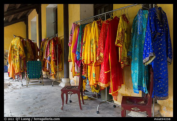 Coat hangers with silk robes in imperial style, citadel. Hue, Vietnam (color)
