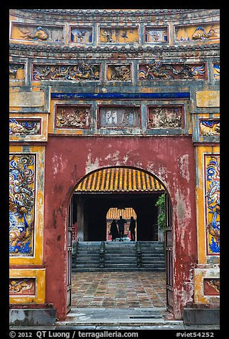Palace and silhouettes seen from doorway, citadel. Hue, Vietnam (color)